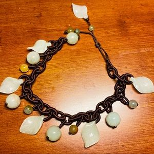 Hand carved and hand knitted jade bracelet